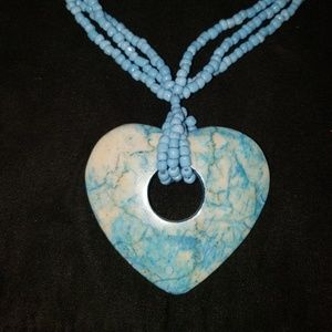 Turquoise beaded necklace w/ heart stone